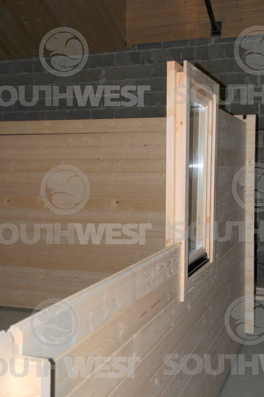 Window fitted to log cabin